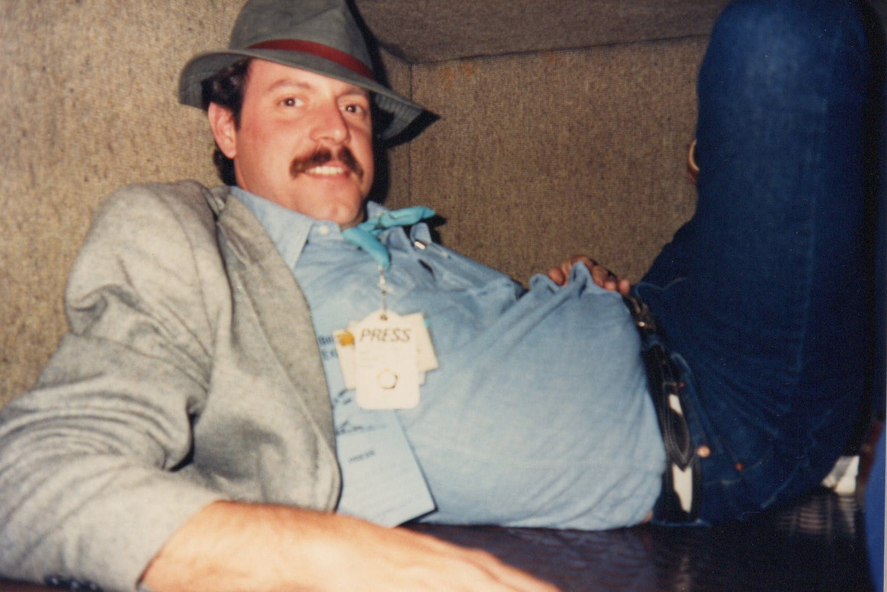 R.G. Ratcliffe hanging out in the luggage compartment of a train during the 1988 Michael Dukakis campaign for president.