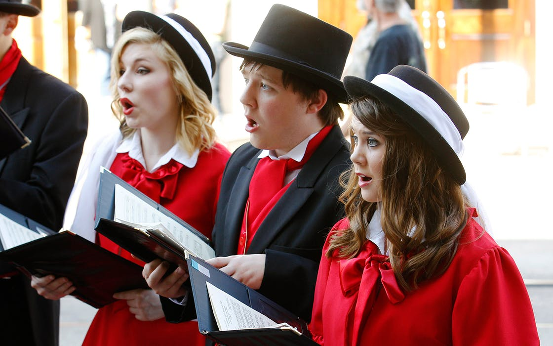 Members of the Belton High School Madrigal sing during the 39th annual Dickens on The Strand festival on December 1, 2012 in Galveston, Texas.