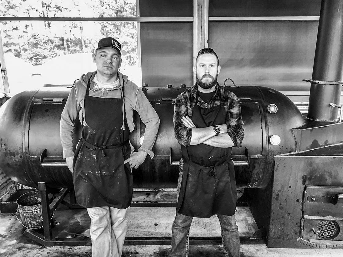 BBQ News Michael Michna (left) and James McFarland in front of their Evie Mae's smoker