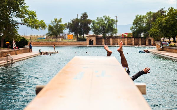 In this July 23, 2012, file photo, a swimmer dives into the spring-fed pool at Balmorhea State Park in Balmorhea, Texas.