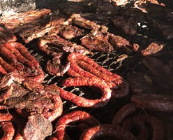 A pit full of meat at Wiatrek's Meat Market