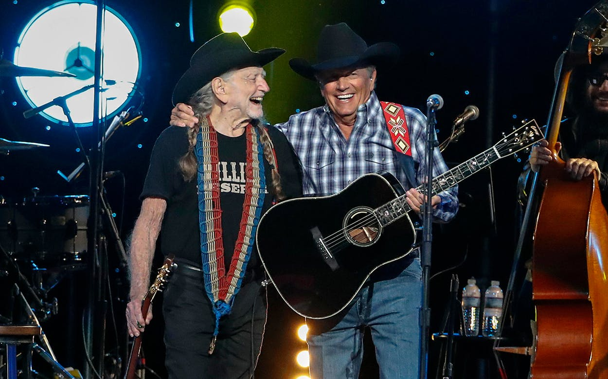 Willie Nelson and George Strait perform at Willie: Life & Songs Of An American Outlaw at Bridgestone Arena