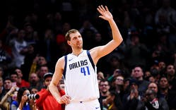 Dirk Nowitzki acknowledges an ovation from the crowd in his final game against the LA Clippers on February 25, 2019 in Los Angeles.