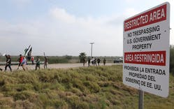 Members of the Carrizo/Comecrudo Tribe along with other opponents of wall construction convened near the river and made their way about 3 miles down to the National Butterfly Center to march in protest on Monday, Feb.4, 2019 in Mission, Texas.