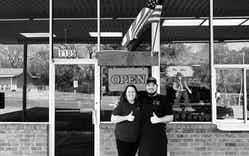 Robin Hightower (left) and Jordan Jackson in front of Bodacious Bar-B-Q in Gladewater