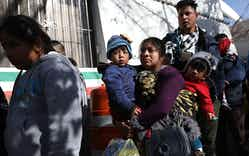 A group of people, some journeying from Honduras, Mexico, Cuba, and Guatemala wait to cross the Paso Del Norte Port of Entry bridge to turn themselves in to the U.S. Customs and Border Protection personnel for asylum consideration on January 13, 2019 in Ciudad Juarez, Mexico.