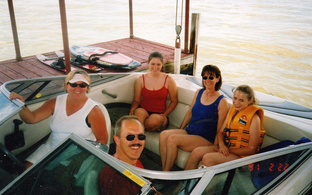 The author (far right) and her family on her uncle's boat, taken in the early 2000s.