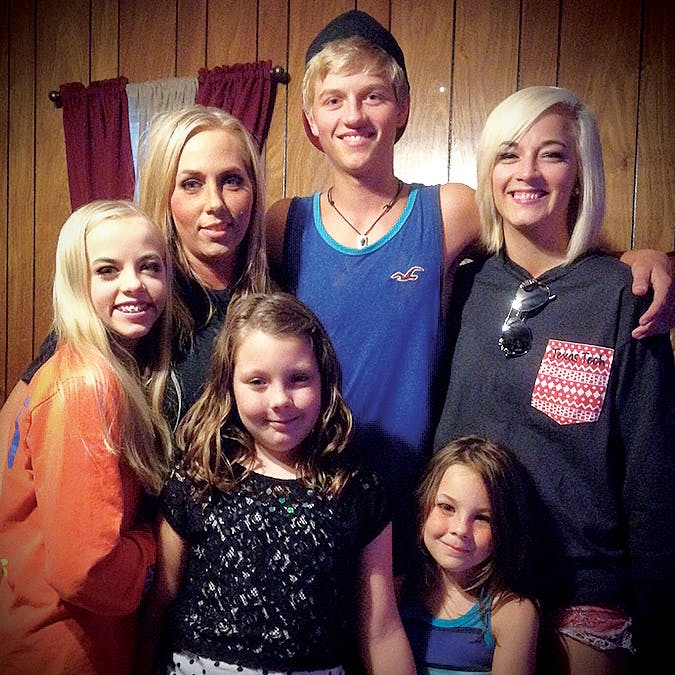 Jennifer Whittmore (second from left) with her children, Ashley, Sean, and Haile Beasley, and her stepdaughters Bailey and Tristyn (in front) on Mother's Day in 2015.