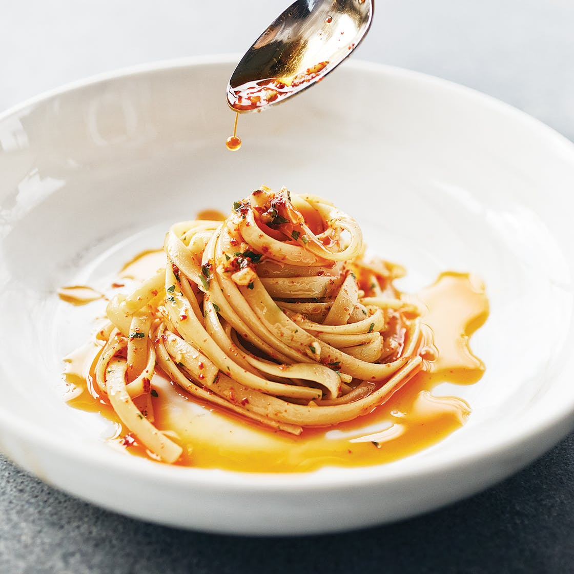 Tagliatelle with red pepper flakes in Texas olive oil.