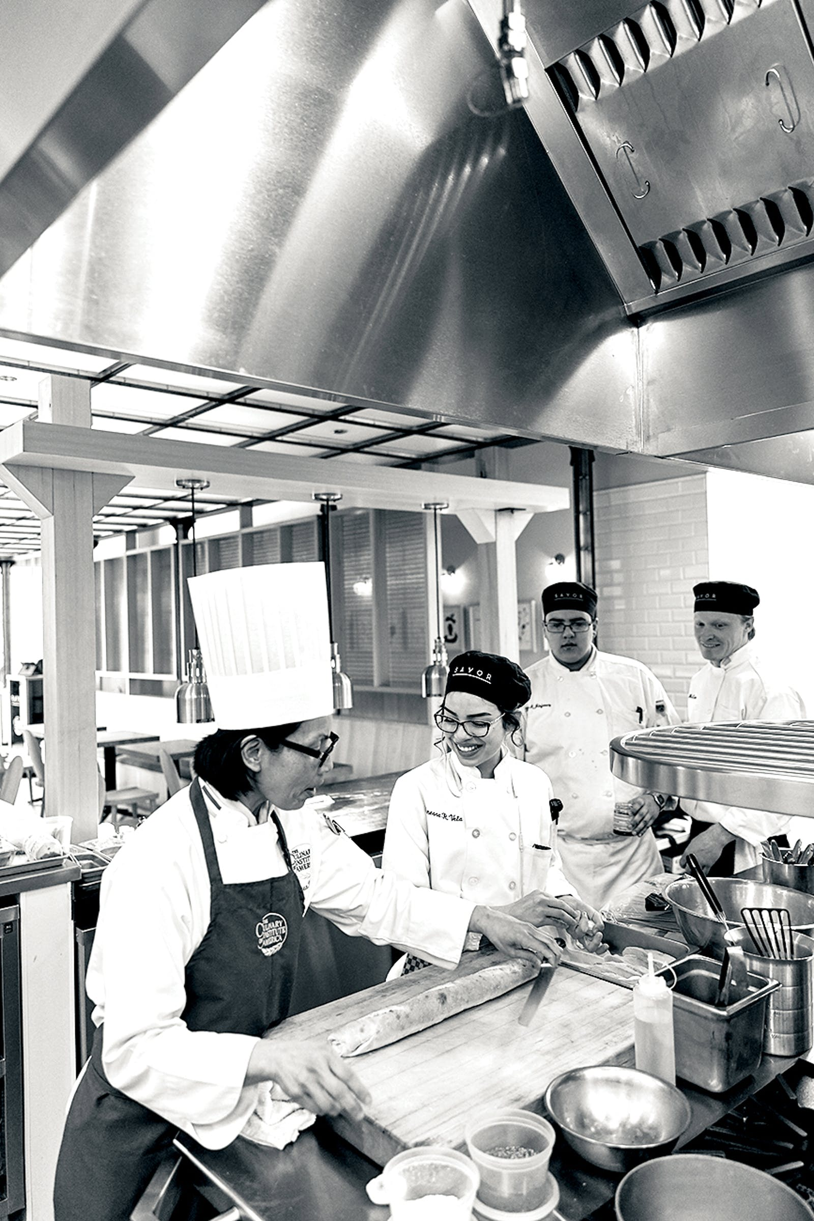 Chef Pham training students.