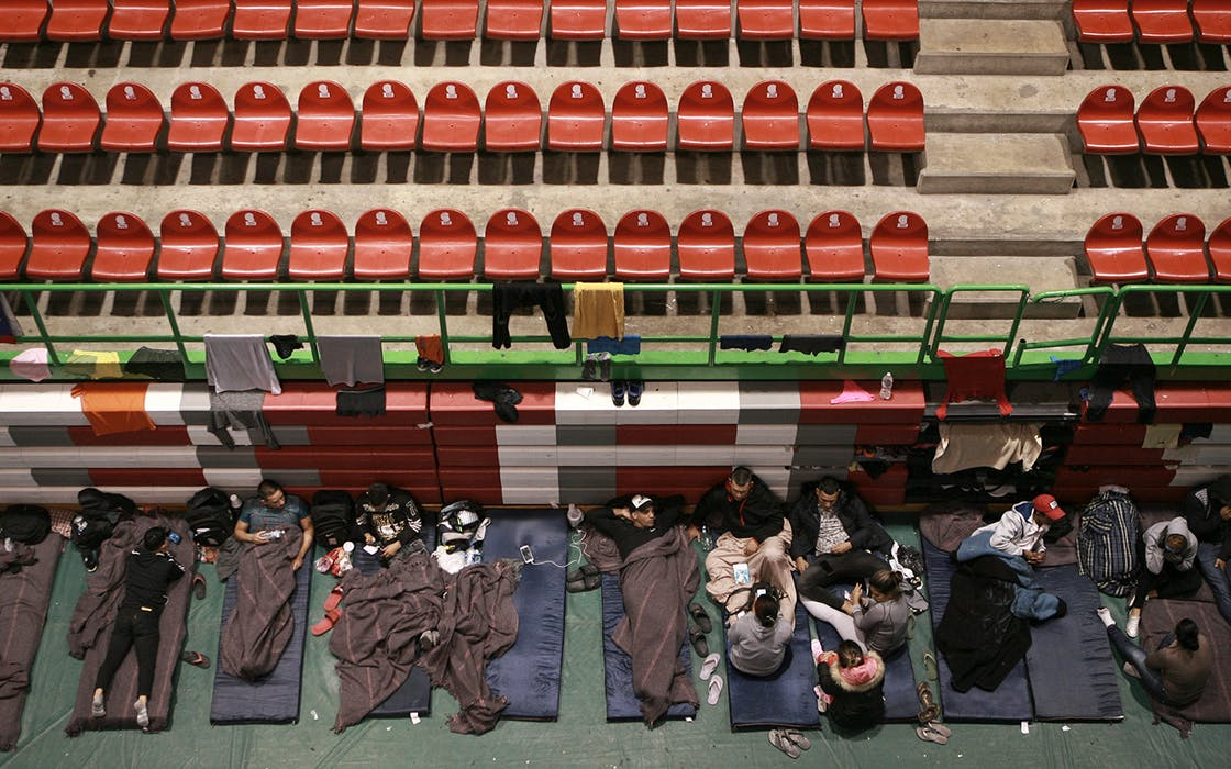 Migrants from Central America, Africa and the Caribbean, who are awaiting their turns to request asylum in the U.S., pass the time inside a shelter in Bachilleres gymnasium in Ciudad Juarez, Mexico, Tuesday, Feb. 19, 2019.