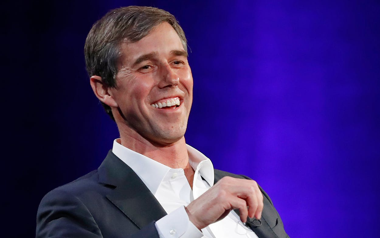 Former Democratic Texas congressman Beto O'Rourke laughs during a live interview with Oprah Winfrey in New York on Feb. 5, 2019.