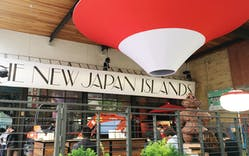 The front patio of New Japan Islands, with an upside-down Mount Fuji structure
