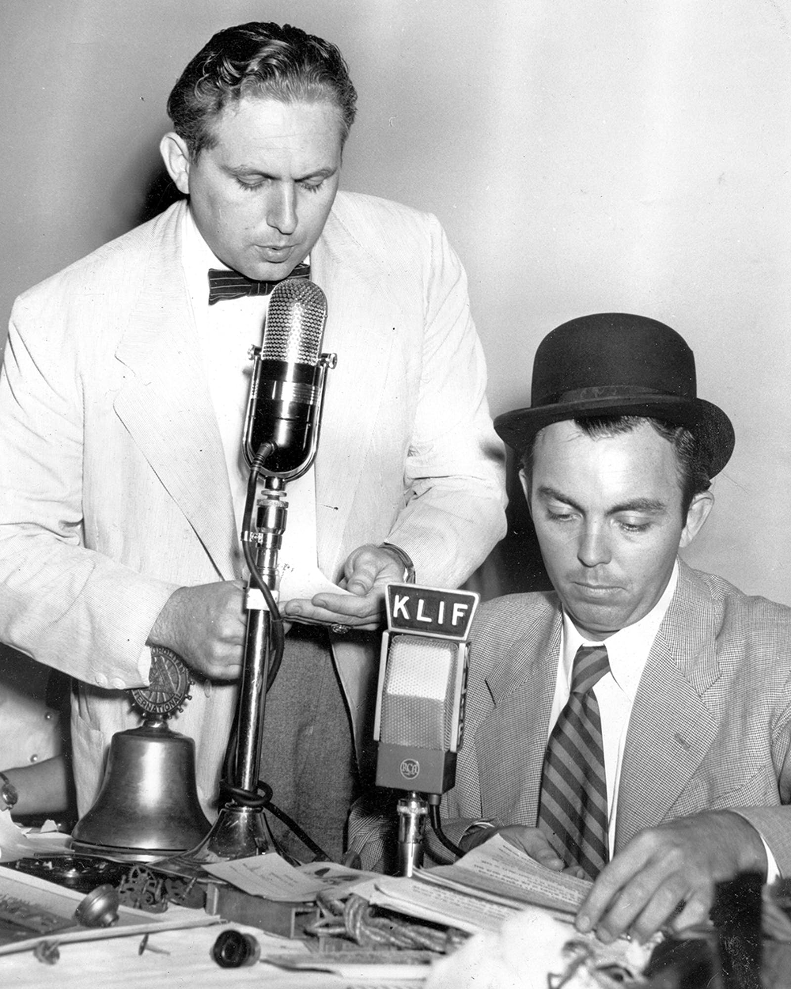 Sporting a bowler, Gordon McLendon and his sound effects man prepare for a baseball game recreation at the KLIF studios.