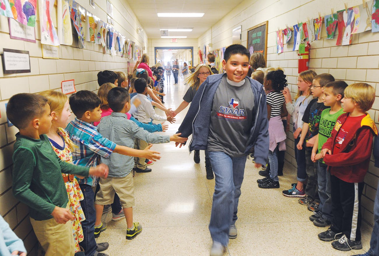 Students at Dyess Elementary School, in Abilene, on their way to take the STAAR test on March 24, 2016.