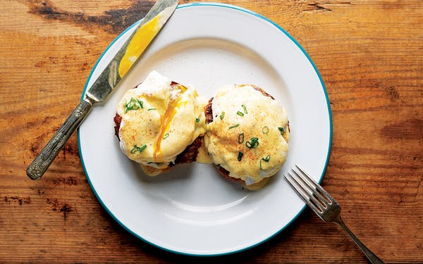 Eggs Benedict with pork sausage.
