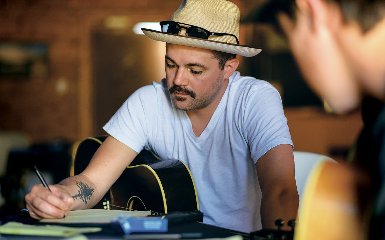 Charlie Shafter tweaking lyrics in his songwriting session with Grant Gilbert at the 806 Songwriter Retreat.