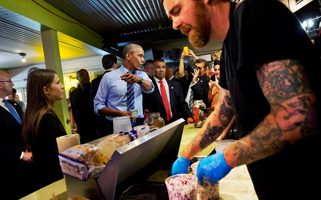 President Barack Obama orders barbecue during a surprise stop at Franklin Barbecue in Austin, Thursday, July 10, 2014.