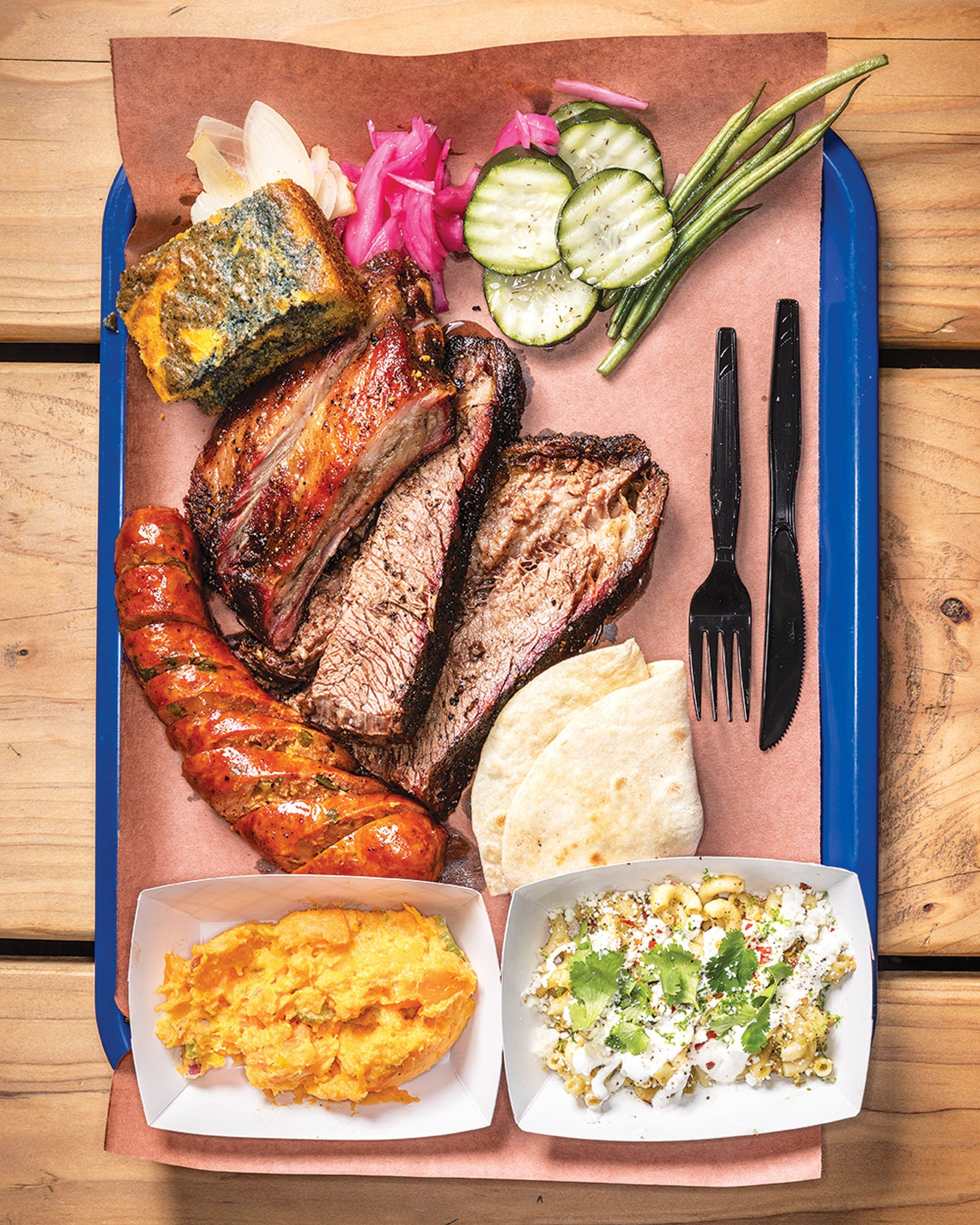 A spread of barbecue and sides at Convenience West.