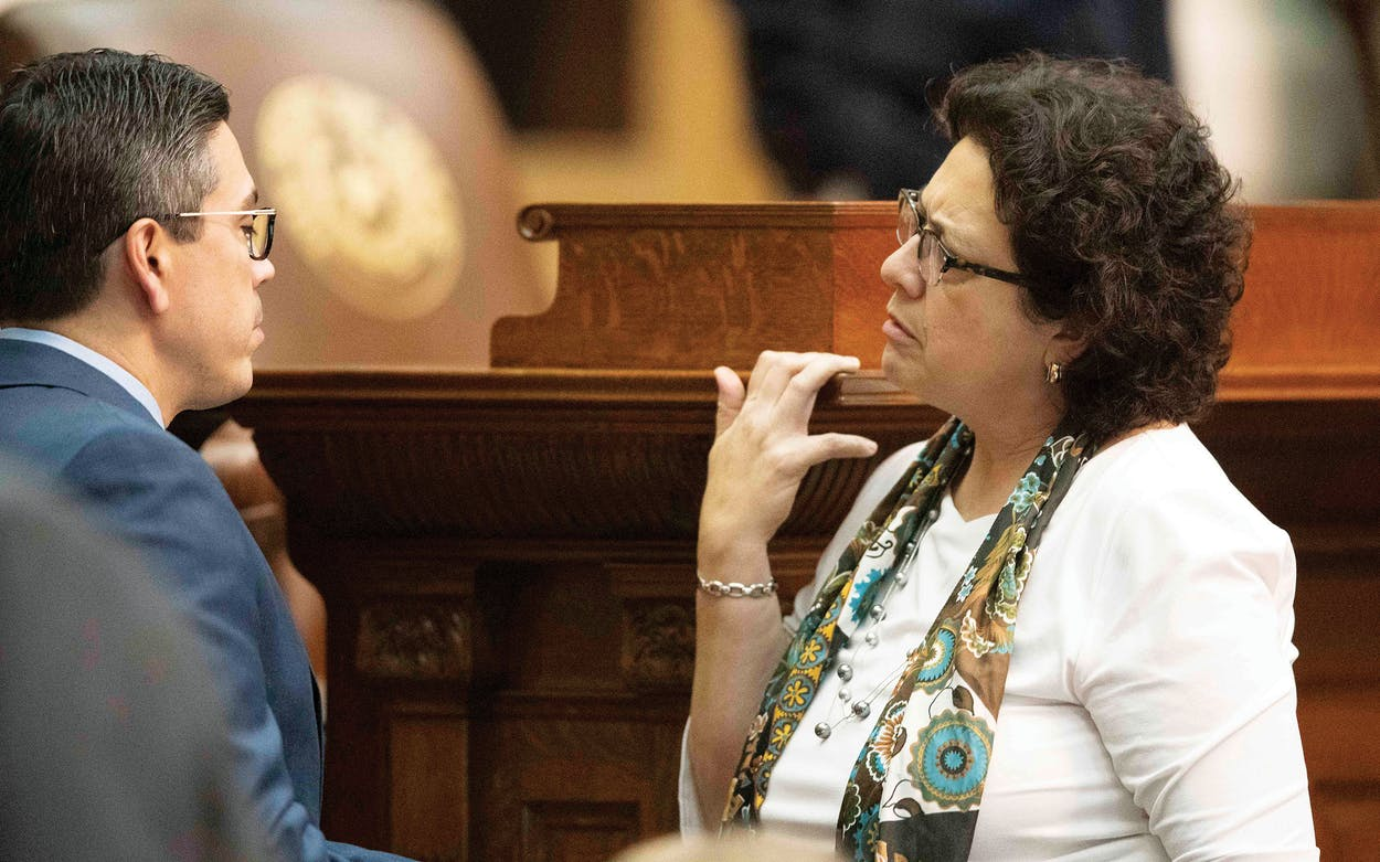 Celia Israel talking to Chris Paddie on the House floor in Austin on March 27, 2019.