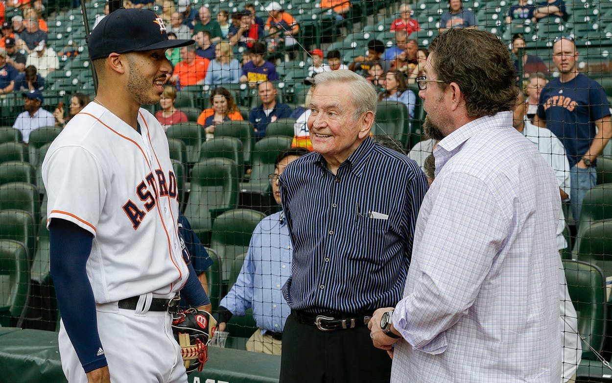 Dave Ward, center, talks with Houston Astros shortstop Carlos Correa #1 and former Houston Astro Jeff Bagwell before throwing out the first pitch at Minute Maid Park on May 9, 2017 in Houston.
