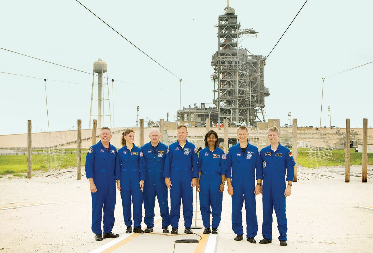 Nowak (second from left) with her Discovery crewmates at the Kennedy Space Center a few weeks before their launch date.