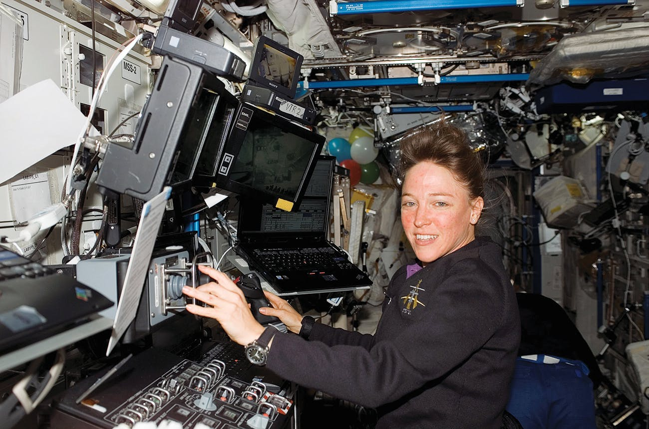 Nowak at work in the International Space Station on July 12, 2006, during her time in orbit as part of the space shuttle Discovery crew.