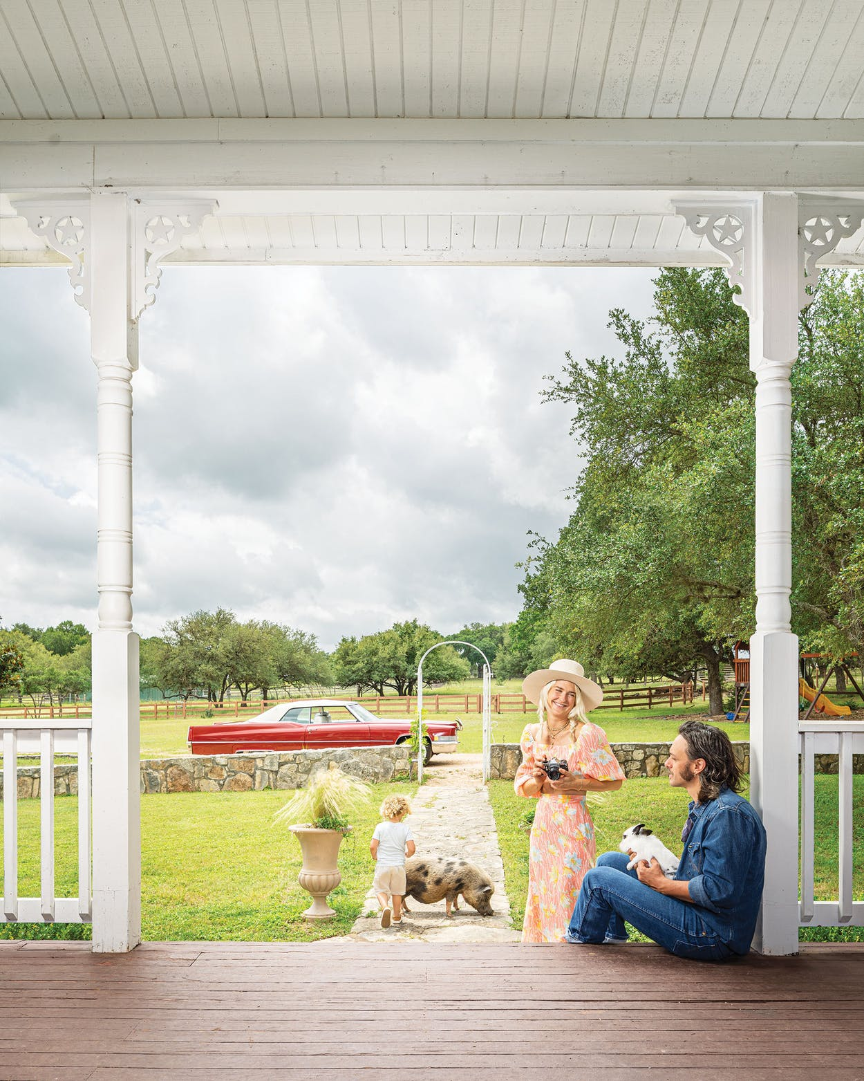 Harper Smith, Cameron Duddy, and their son outside of their home in Dripping Springs on May 17, 2019.