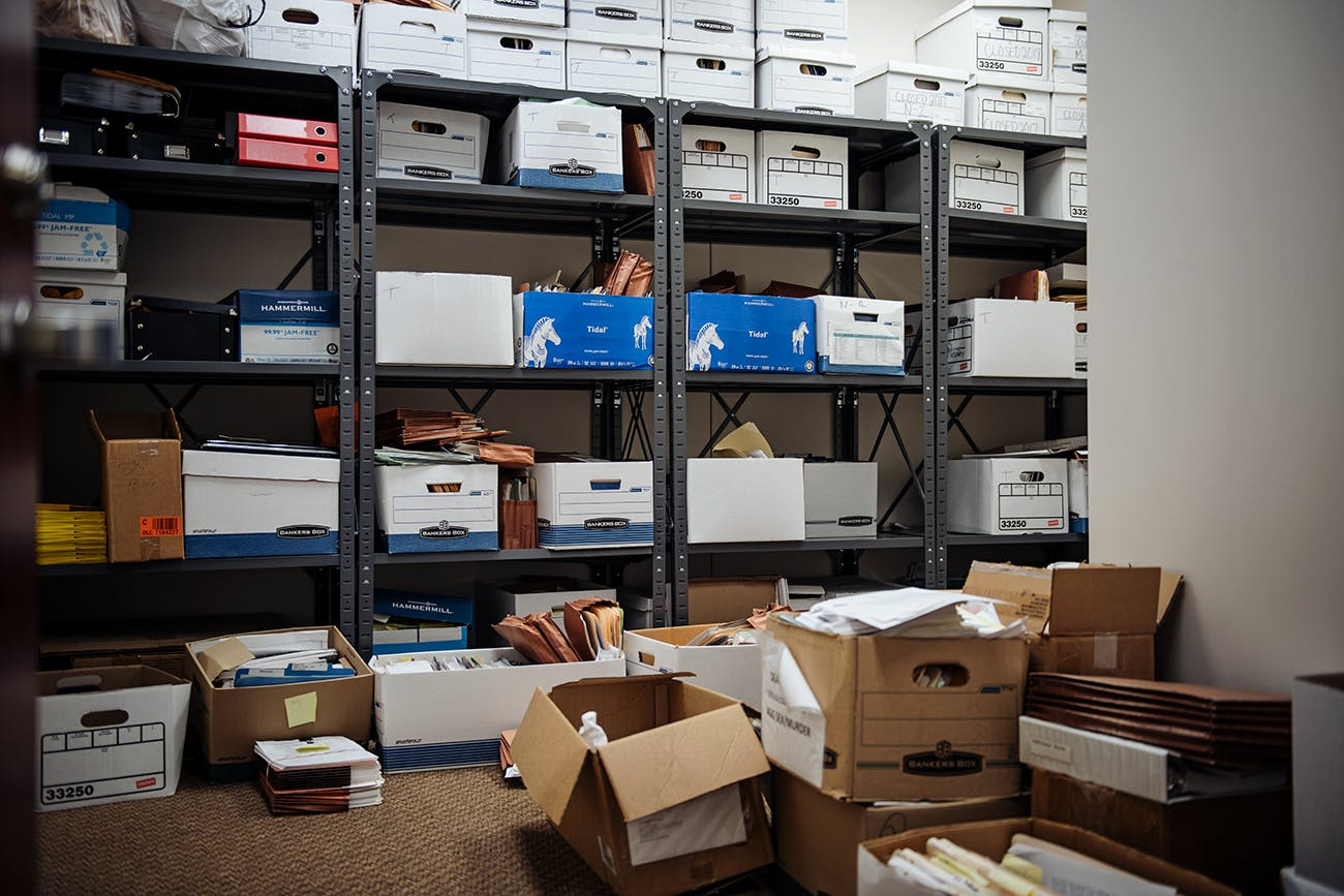 Boxes of case files at the Harris County public defender's office, in Houston.