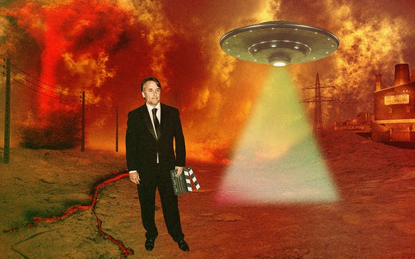 Richard Linklater standing in a futuristic nightmare landscape while a UFO flies in the background.