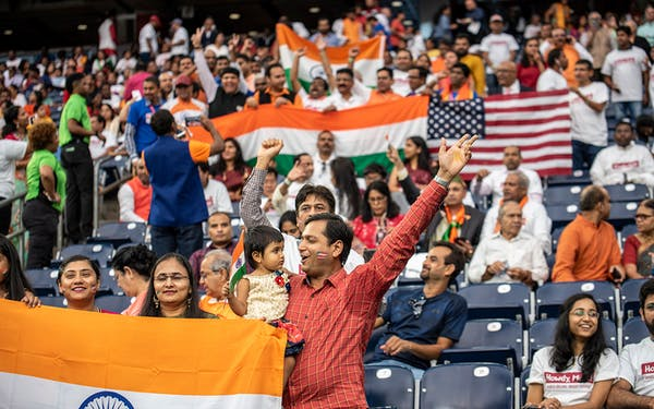 Attendees chant and cheer inside NRG Stadium ahead of a visit by Indian Prime Minister Nerenda Modi on September 22, 2019 in Houston.