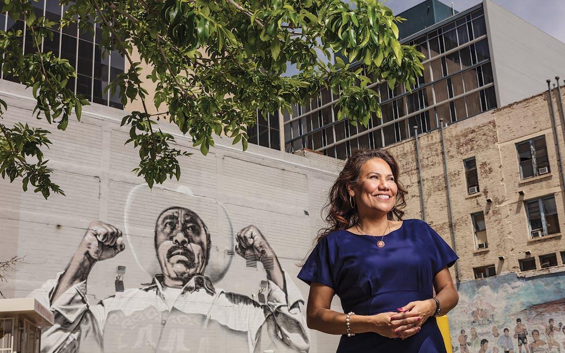 Escobar in front of a mural by artist El Mac in downtown El Paso on April 6, 2019.