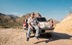 Postman Gilbert Lujan and his truck on Pinto Canyon Road.