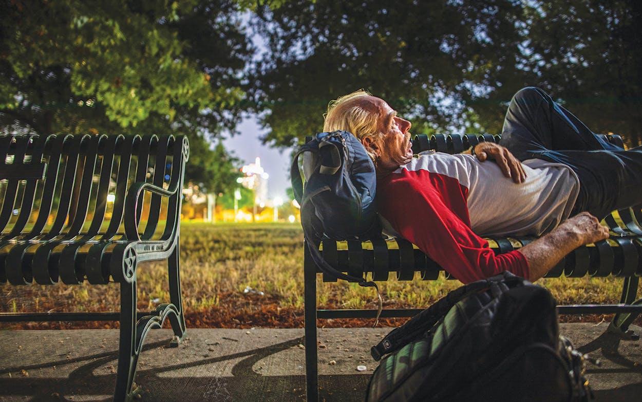 Alvin Sanderson rests on a bench.