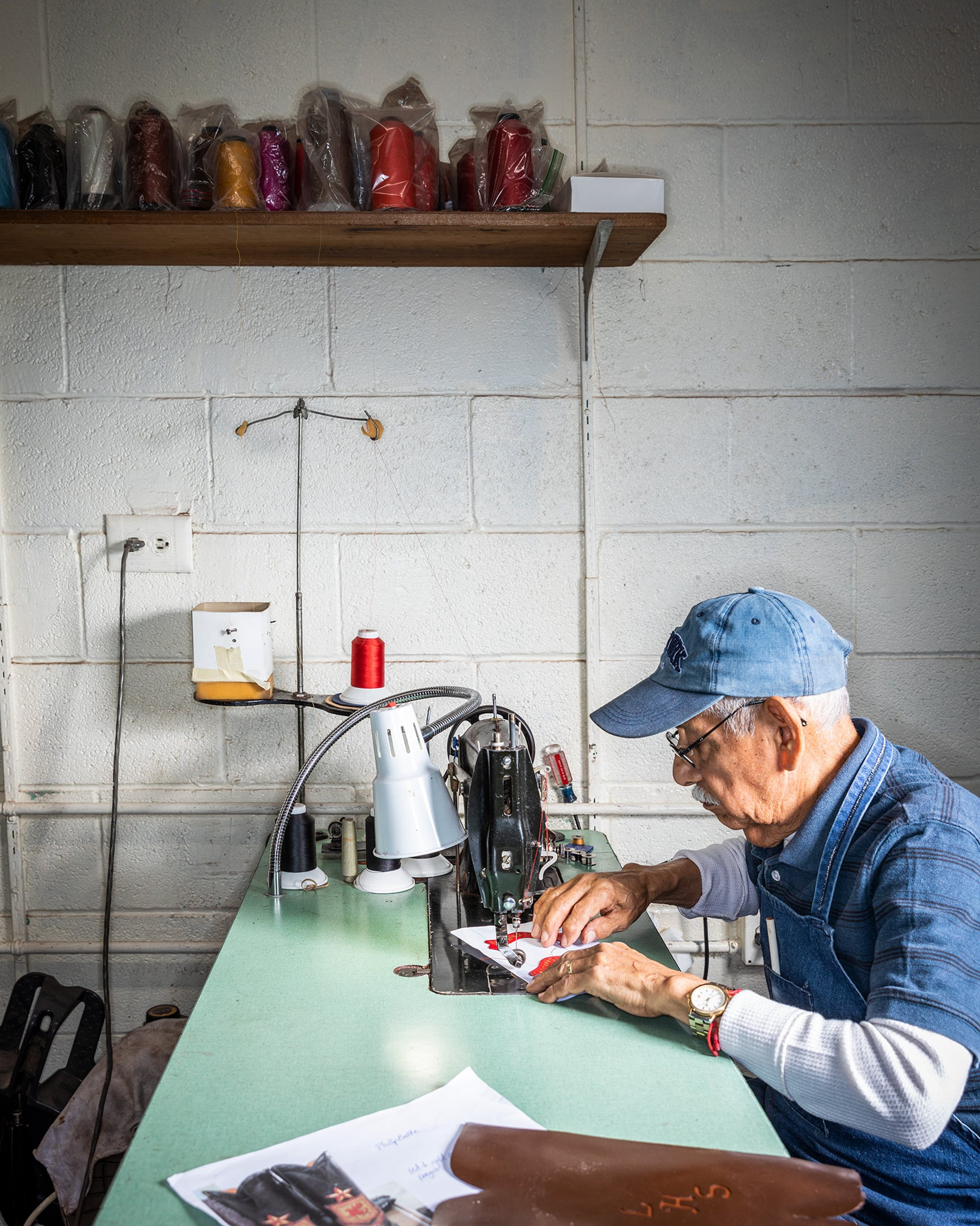 Juan O. Ortiz, who has worked at Little's for 33 years, mans a classic Singer 31-15 sewing machine, stitching inlays that will decorate a boot's shaft.