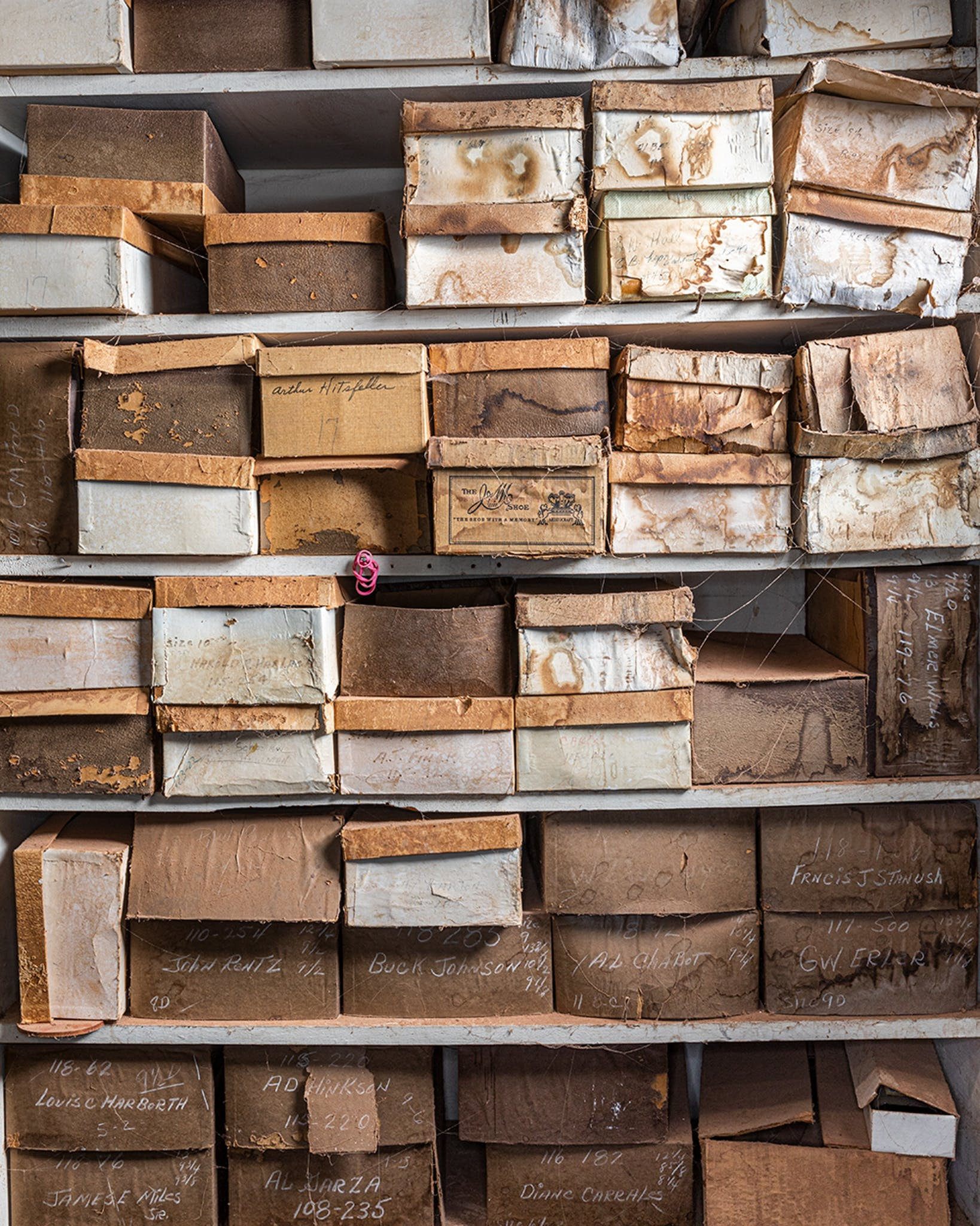 Weathered boxes containing lasts belonging to some of Little's oldest customers.