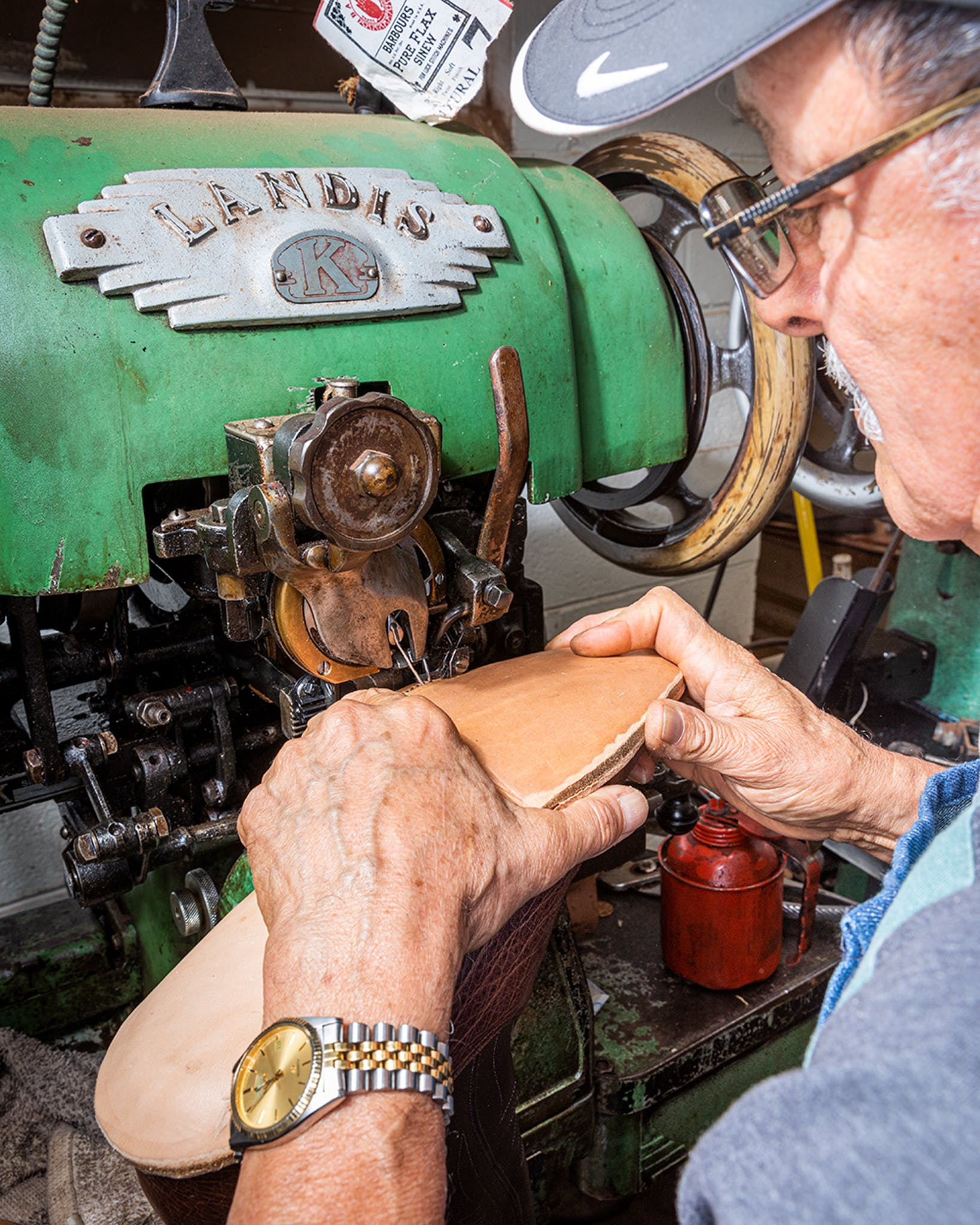 Rafael Moreno, who has crafted boots at Little's for 12 years, stitches a heavy-duty leather sole into place with an ancient industrial sewing machine designed just for this purpose.