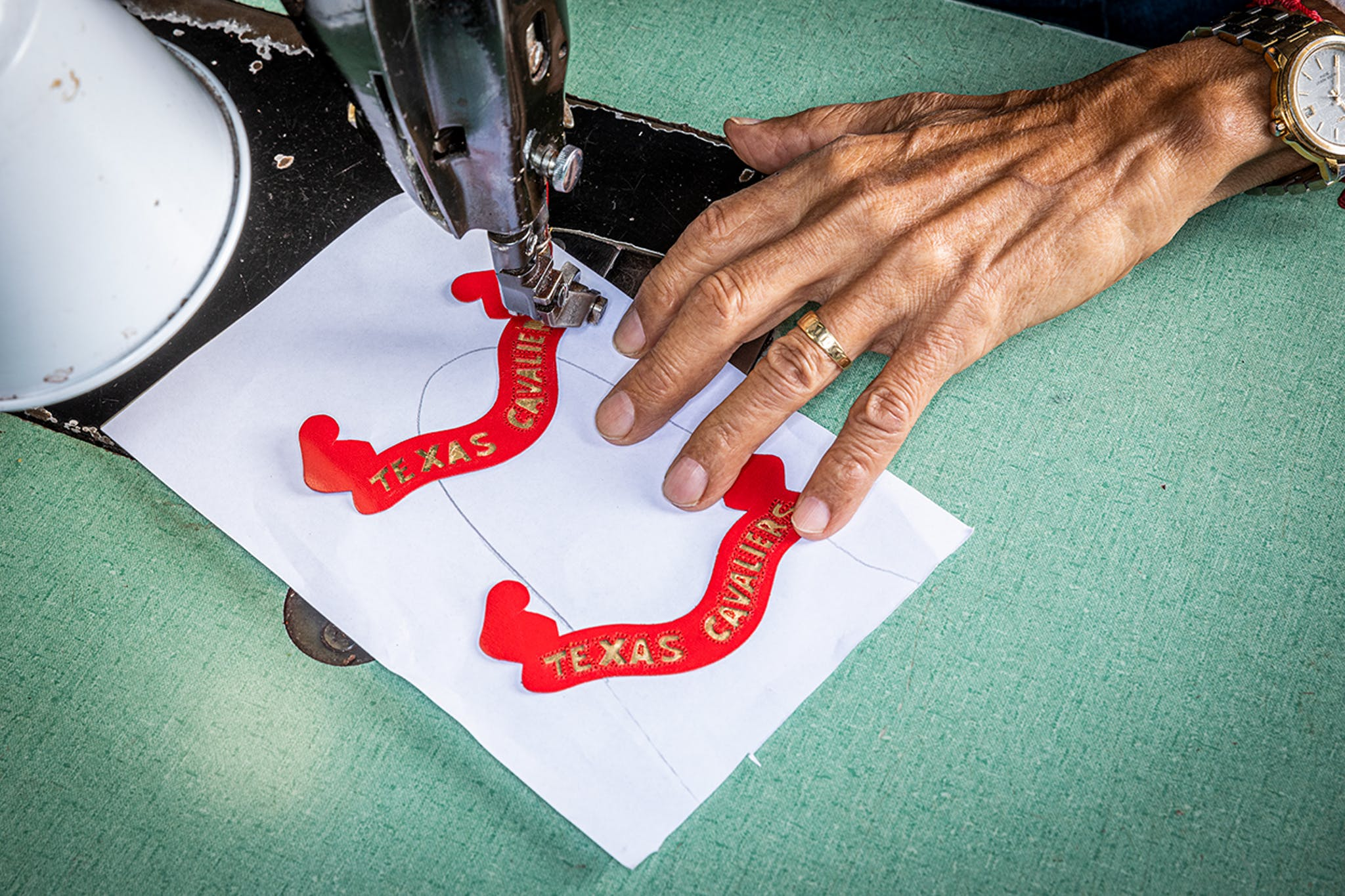 Ortiz works on the fine stitching required for a boot's ornamental inlays.