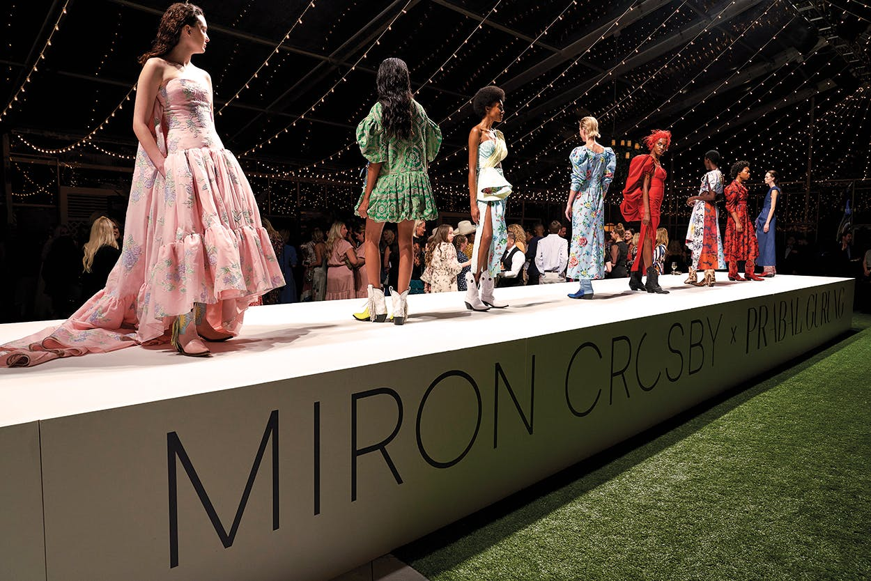 Models walk the runway during the launch celebration of the Miron Crosby boot line designed in partnership with Prabal Gurung.
