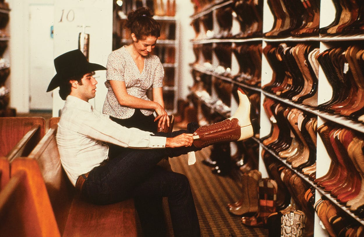 John Travolta prepping for the 1980 film Urban Cowboy, which helped spark a nationwide boot craze.