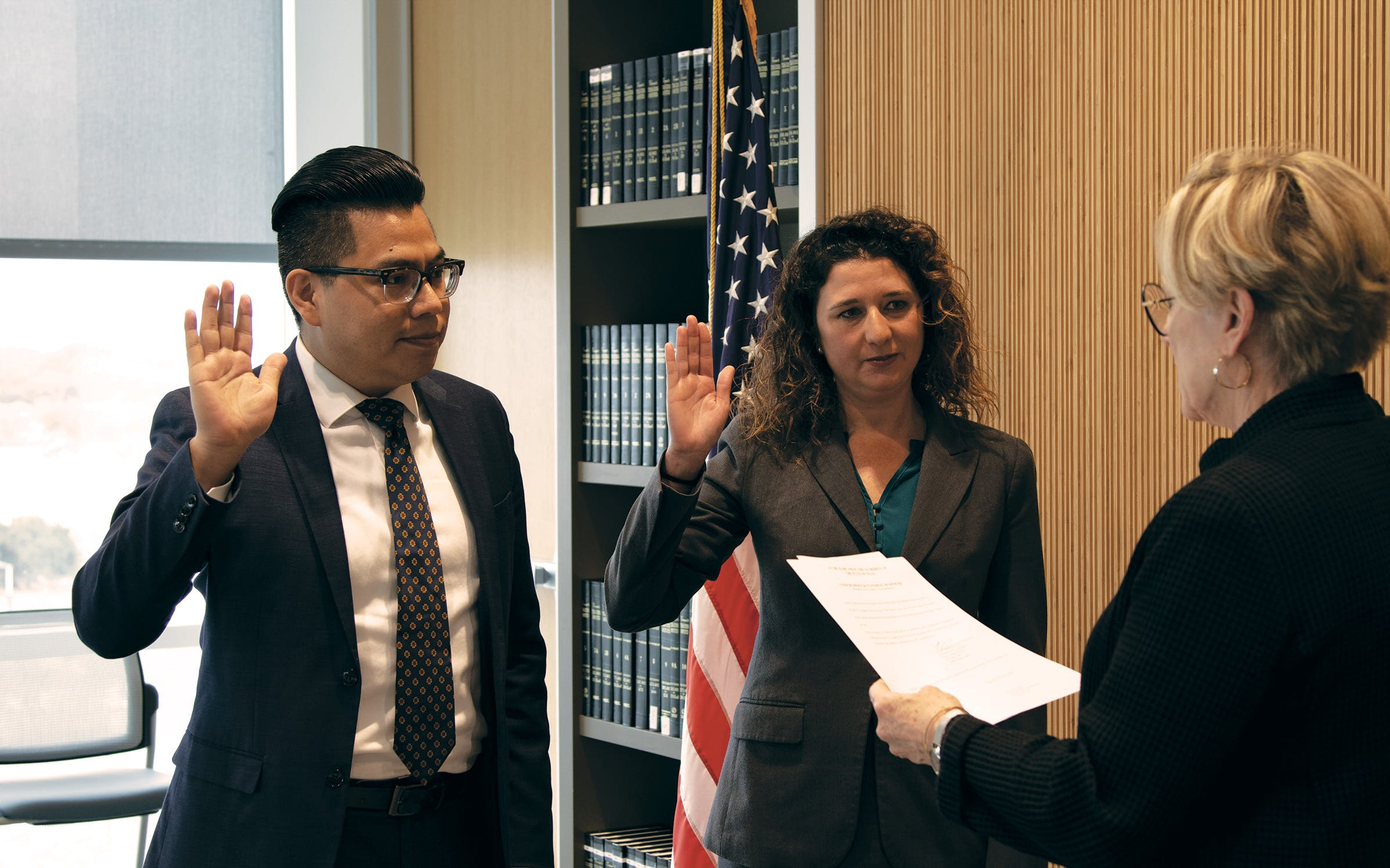 District Attorney Margaret Moore (far right) swearing in Villalobos (left) and fellow lawyer Gwen Jacobs in Austin on December 16, 2019.