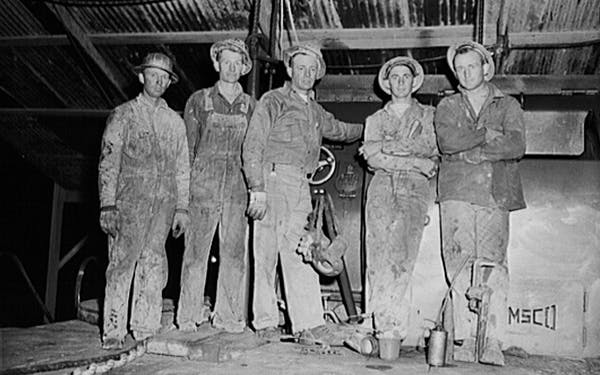 Driller and roughnecks on night tour in Andrews County in November 1942 for boomtown
