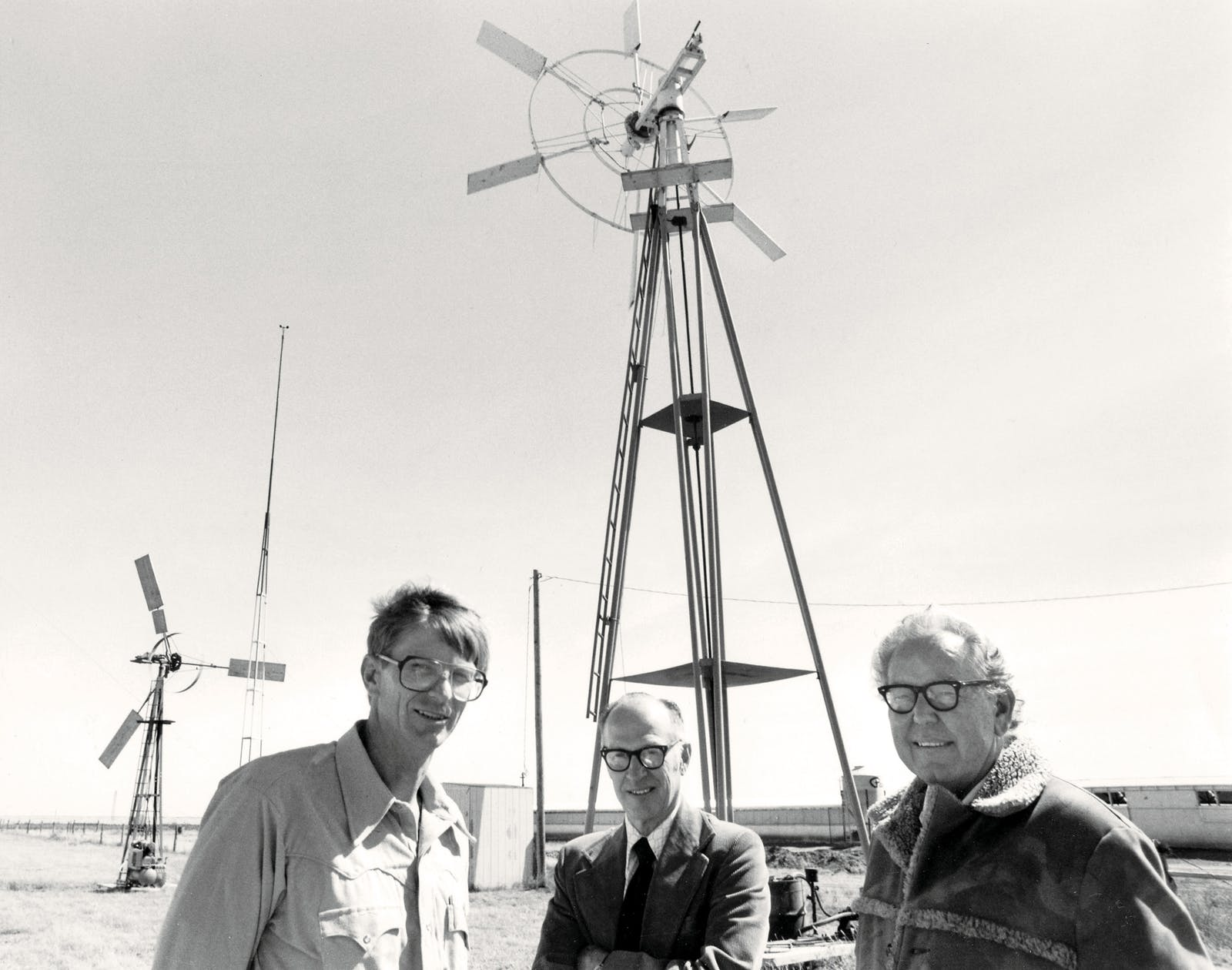 Co-founders Vaughn Nelson, Earl Gilmore, and Robert Barieau in front of the Alternative Energy Institute's Wind Test Center at West Texas State University, in Canyon, in the late seventies.