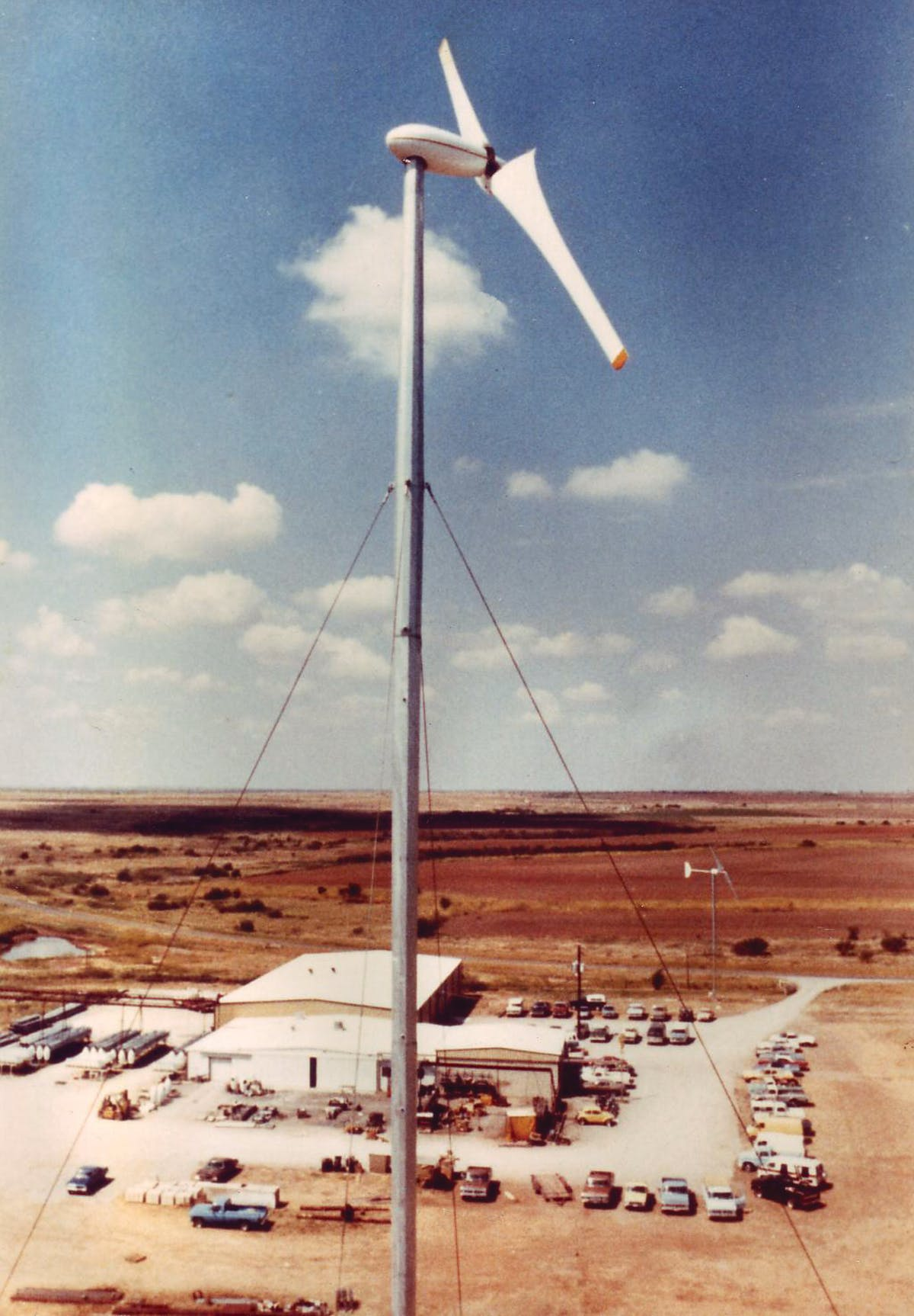 A prototype turbine built by Carter Wind Systems stands over the company's Burkburnett manufacturing plant, circa 1982.