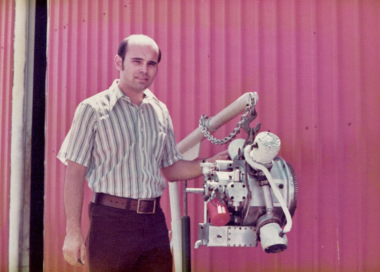 Jay Carter Jr. beside a prototype of his steam engine in Burkburnett in the early seventies.
