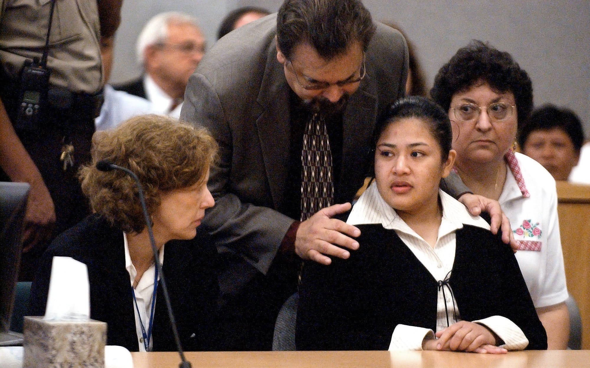 Rosa Jimenez' lawyer Leonard Martinez talks to her along with Catherine Haenni, left, and interpretor Maria Celeste Costley, right, in Judge Jon Wisser's courtroom on August 31, 2005. The jury came back with a verdict of guilty.