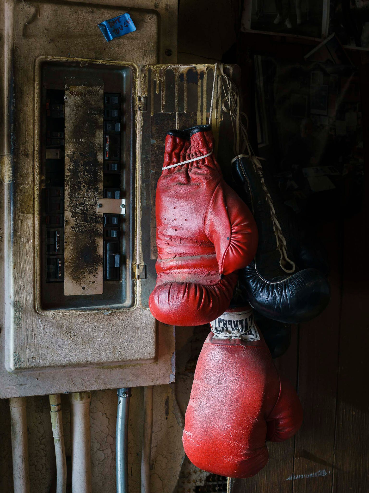"""""""This is pure Doug,"""" says Diamond, of the boxing gloves draped lazily over a fuse box that looks ready to short circuit. (The little blue note reads, """"Don't Touch."""") The fuse box clung to the wall of Eidd's office, and the gloves never left their perch. The leather and metal, the paint drips and pipes, the intense dark shadows and the glint of light on leather give this picture the feel of a still-life painting."""