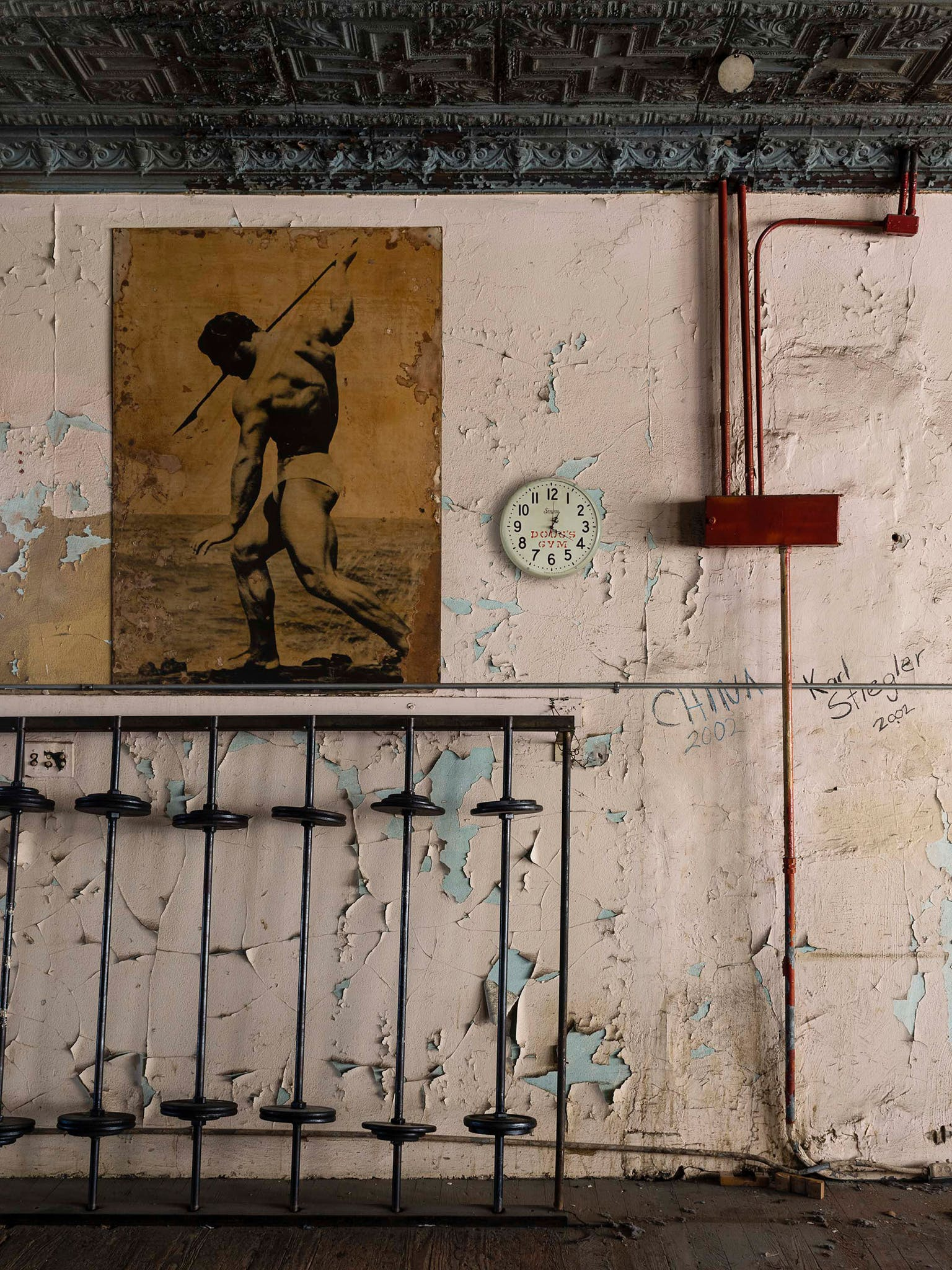 Of the more than 3,000 pictures Diamond took, this is one of his favorites. There's a starkness to the image, but mostly a sense of decay: the faded poster (of '36 Olympian John Grimek), the fossilized floor, all that slowly peeling paint.