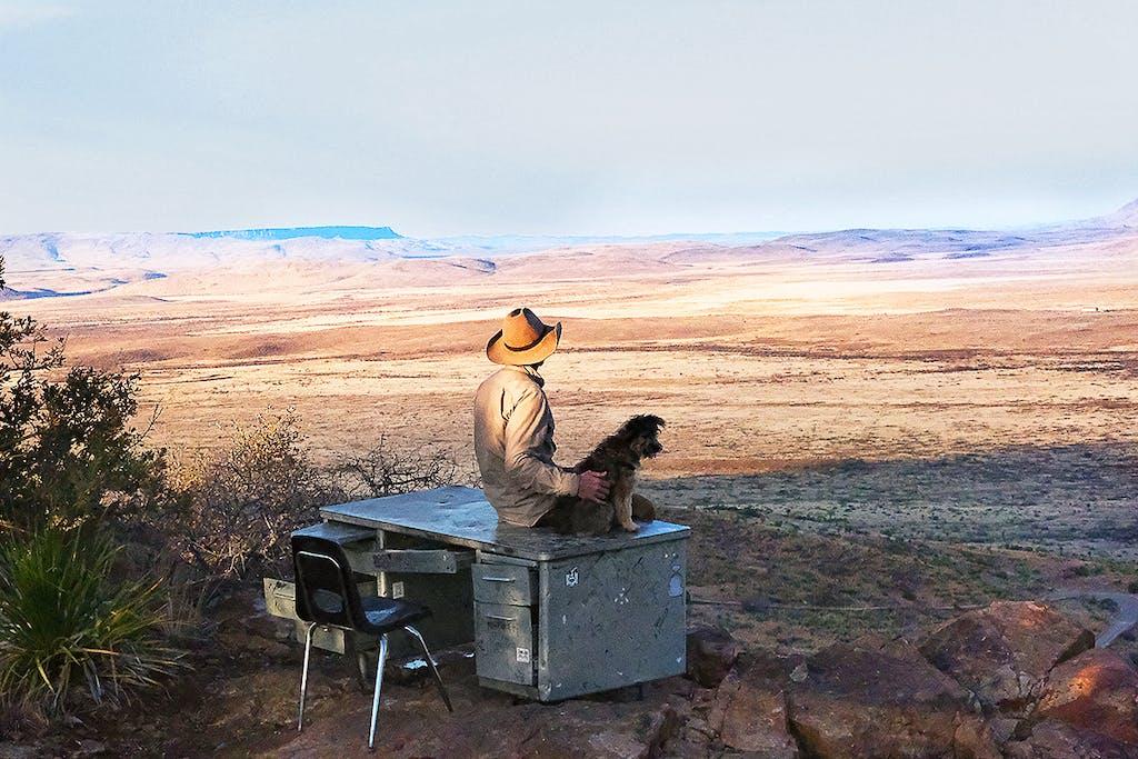 man-sits-with-dog-at-big-bend-desk-1