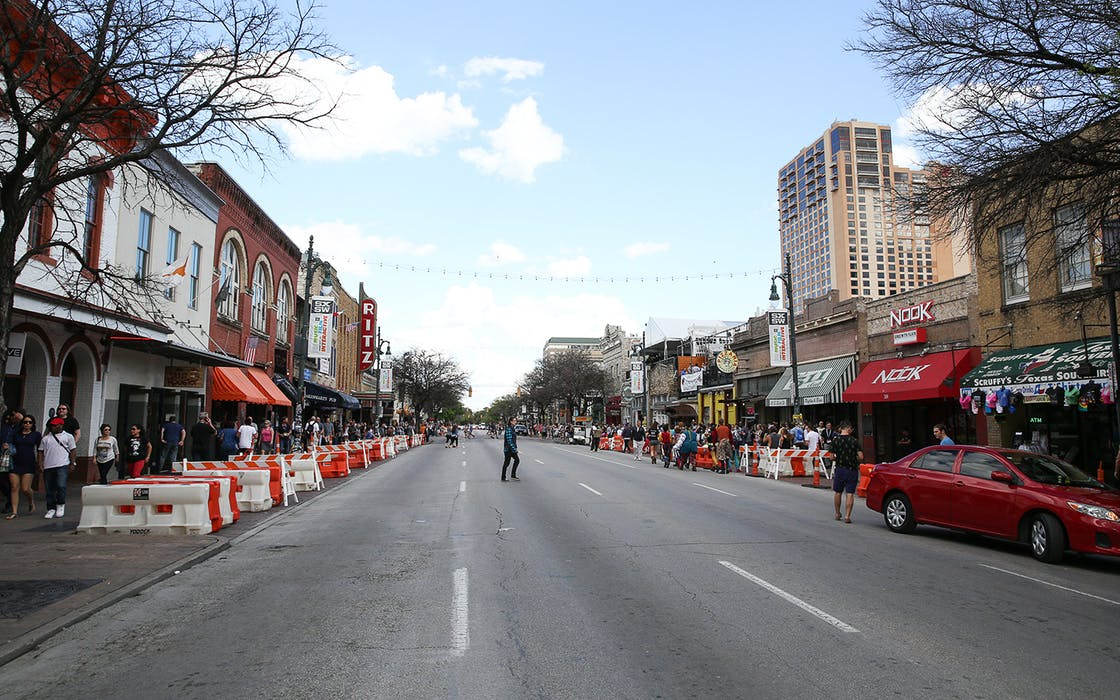 Crowds walk down Sixth Street during South By Southwest on Saturday, March 12, 2016, in Austin, Texas.